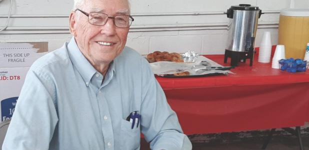 """Bob Senjem autographed copies of his book, """"Pages of Oslo,"""" for a large number of neighbors and friends at a book signing event at the Oslo Sinclair Station last July."""