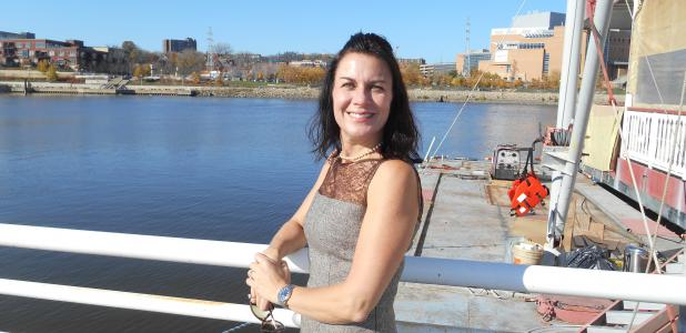 For the first time in history, the Centennial Showboat, docked off Harriet Island, is being used as a venue for a historical display. Amy Noble Seitz, founder and CEO of Exhibits Development Group, is shown alongside the boat, a home to Treasures of Napoléon exhibit in St. Paul until Jan. 10, 2016.
