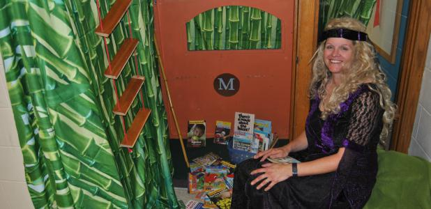 Shelia Brandt dresses as Morgan le Fay from the Magic Tree House book series. She gave out books and candy to visiting children.