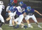 Kasson-Mantorville's Jackson Kennedy #42 with the tackle.