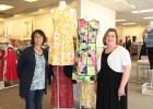 Long-time store associate Kathy Krueger (left) and store manager Jennifer Anderson stand in front of a display at the Medford Outlet Center's Dressbarn. The store celebrated its 20th year of being located at the center in March.