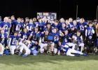 The Kasson-Mantorville varsity football team posed last week on the field after winning the Section 1AAAA championship. The KoMets defeated the Byron Bears 7-0.