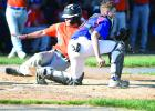 Post 333 catcher Nick Van Camp receives a late throw as a Century High School player scores from third base.